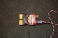 Name: Sandancer_Quanum_Temp_AMP_Module_XT60_6-18-2011_0005.jpg Views: 77 Size: 236.3 KB Description: Finished up with some 25mm heat shrink.