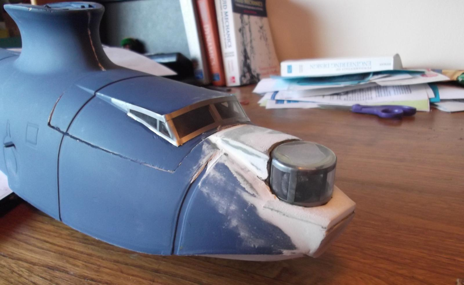 New nose with box features made of depron, a crest shaped wood plate at the front and a random piece of thermoplastic packaging for the turret.
