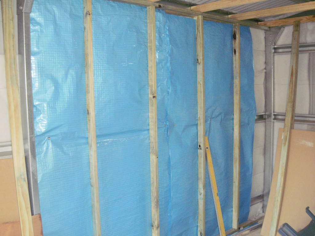 insulation pads backed with foil insulation and treated pine frame in one panel so far.