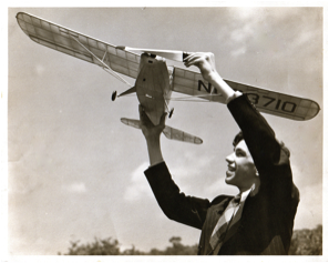 Oscar with a free flight model airplane he built (1942)