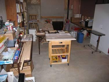 01 - My original small mobile building bench in the unfinished basement.  Inexpensive knock-down tables from an office supply store provided additional work surfaces.