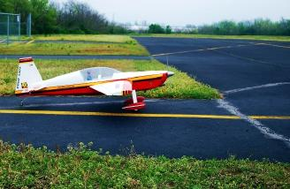The pilot taxis his shiny new aerobat to the active runway...well the only runway.