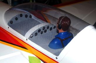 After adding the instrument panels I put a pilot figure in the rear cockpit - gotta have someone to blame those not-so-greaser landings on, you know, if they ever happen...which I doubt they will...but just in case. After adding the pilot and instruments I screwed the canopy back in place.