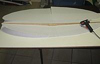 Name: 105 glue spar.jpg Views: 94 Size: 93.0 KB Description: wing spar is hot glued on side at a time