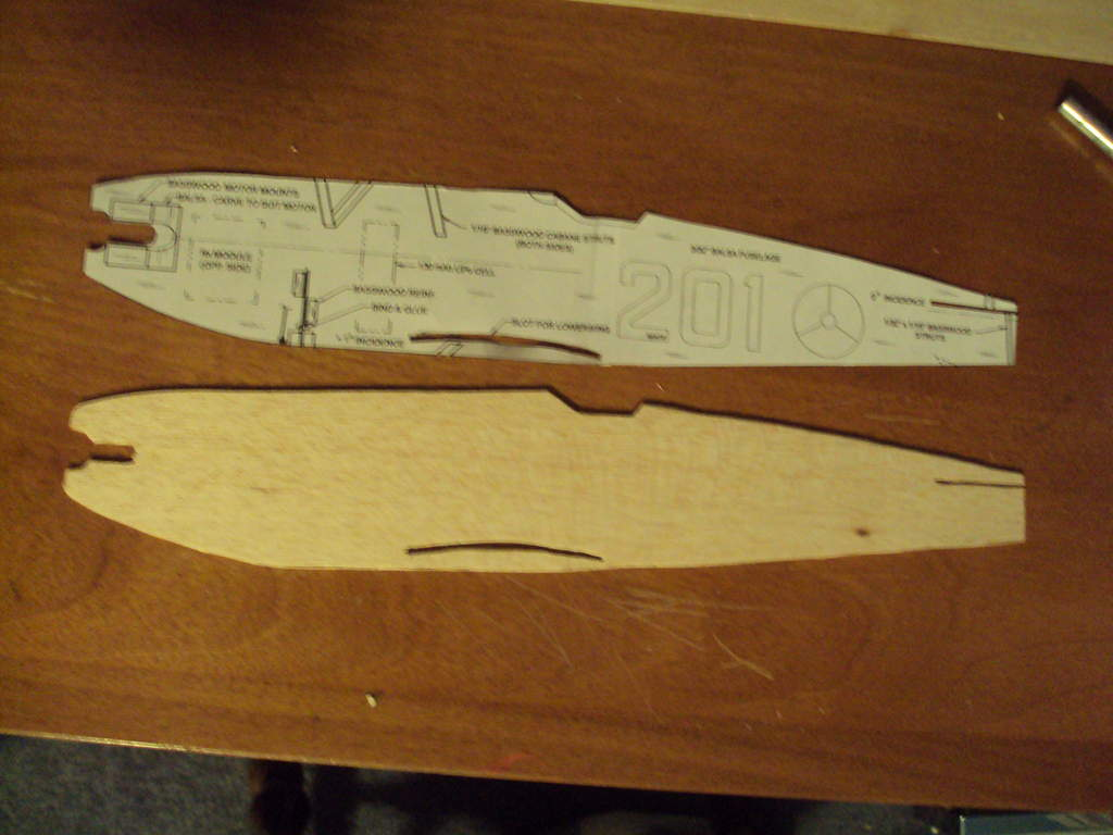 Cut it out of 1mm balsa