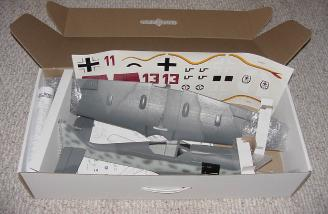 The kit contents are complete, minus motor, battery, speed control (ESC) and radio components. Notice the cardboard catches that hold the plane in place during transport.