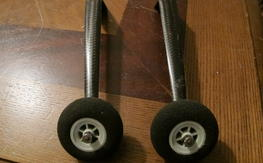 Two piece carbon fiber landing gear with wheels
