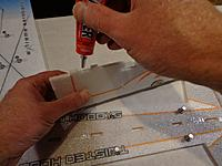 Name: CYSL-038A.jpg Views: 254 Size: 78.3 KB Description: Apply glue in the same fashion to the butt joint area of the lower vertical fuselage section. Note - no glue on the tabs at this time