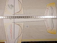 Name: DSC05329.jpg Views: 70 Size: 475.7 KB Description: Cut them to length and fit into the pre cut slot. Make sure all the fuselage slots are still all in line with each other