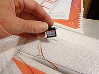 Name: DSC05412.jpg Views: 64 Size: 471.3 KB Description: Fit the rudder servo into it's position