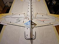 Name: DSC05371.jpg Views: 53 Size: 471.1 KB Description: Dry fit all four rods as shown. Adjust the in their slots so that the fuselage is square