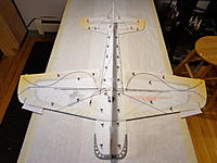 Name: DSC05381.jpg Views: 68 Size: 449.5 KB Description: Dry fit ALL the braces. Note that there are tiny slots to locate the ends of each rod. Adjust the rods to get the fuselage perfectly square and true.