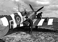 Name: 411+Squadron+RCAF+ground+crew+members+apply+invasion+stripes+to+Spitfire+Mk+IXe+DBR+serial+no+RR.jpg