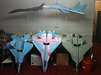 Name: Two PAK FA's and a Raptor.jpg