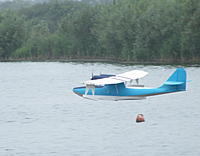 """Name: 2012_09020013.jpg Views: 95 Size: 213.4 KB Description: 29. Pentaxman's Ivan Pettigrew plan Catalina (the 84"""" span one) on it's (and his) first water flight at the BIMBO weekend September 2012, exactly a year after the first flight off the Reservoir."""