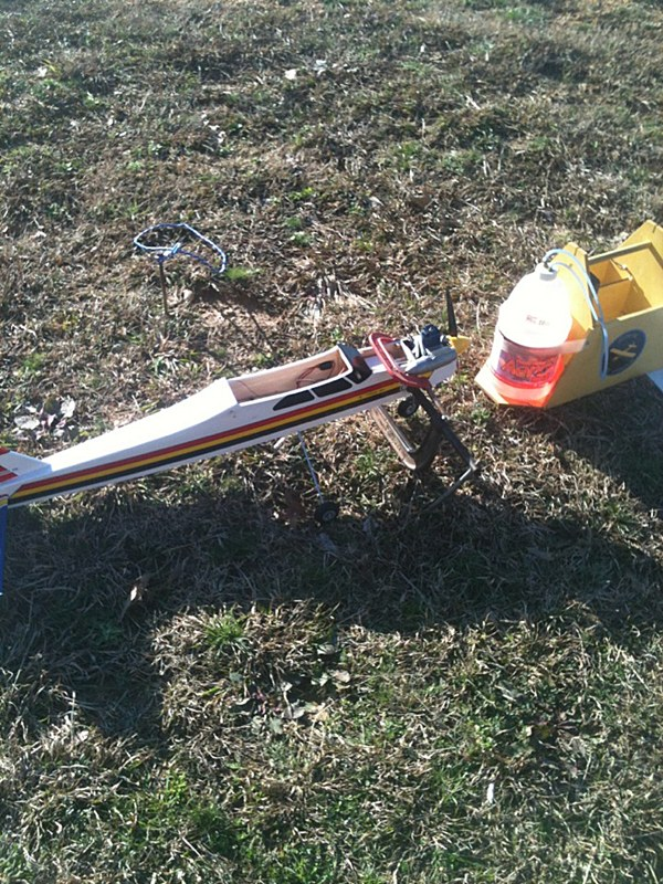 This is a pic of it sitting out in the sun drying the epoxy that i put on it agter it broke.  That big C clamp on the bottom is holding the plane down.  The wind was blowing like crazy.