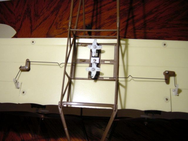 Look at the wires from bell cranks. Wire on right is correctly connected, wire on the left is not, note angle.