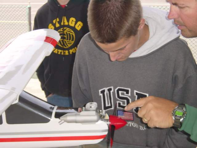 Jeff instructing Ross about the engine's choke and the engine in general. Note the spin control airfoil extension on the wing.