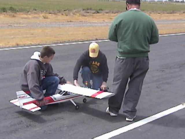 While Ross secures the plane, Andy gets ready to start it.