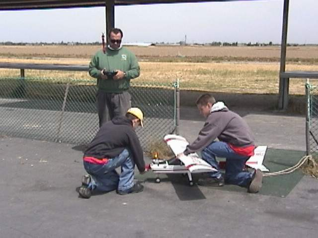 Here the tail is secured with a rope and Ross is holding it firmly while Andy starts up the plane.