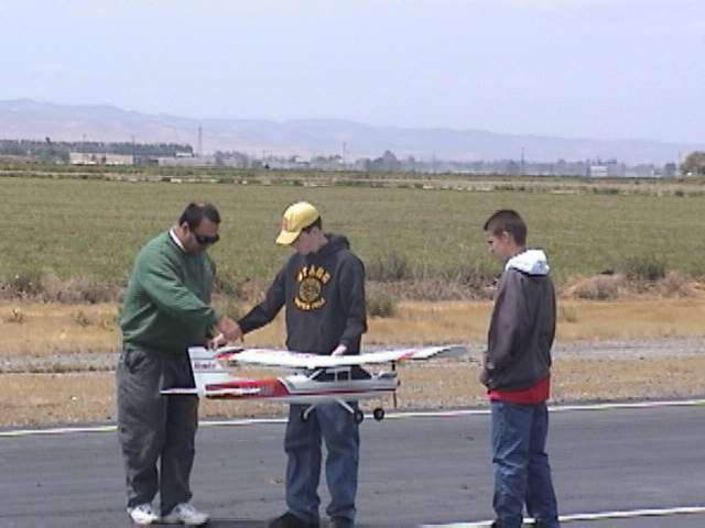 Here is Jeff teaching them how to carry the plane back to the pits from the left or