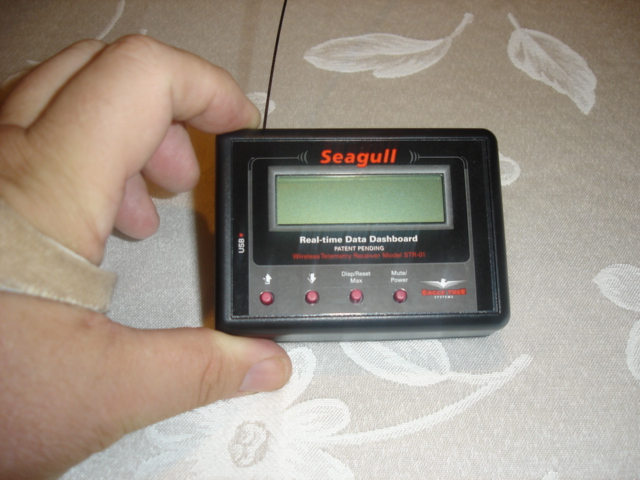 This is the new Seagull wireless Dashboard. It includes a plastic clip for mounting to the radio transmitter's antenna.