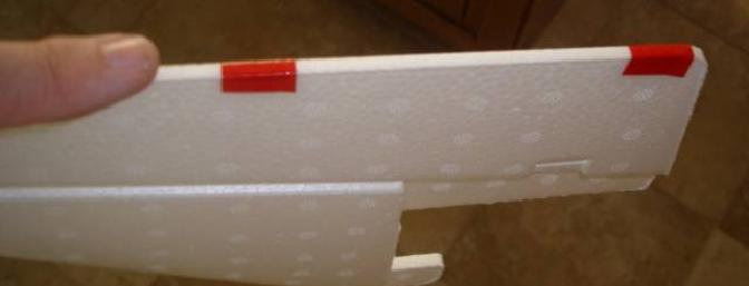 The tape helps show how wide the rudder is. By tapering it through sanding the drag it produces will be reduced.