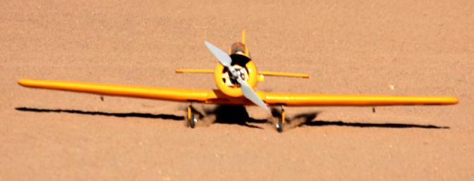A student pilot touches down on a sandy runway and earns his wings with the Texan.