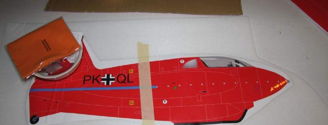 The right side fuselage applique taped to the foam in the center.