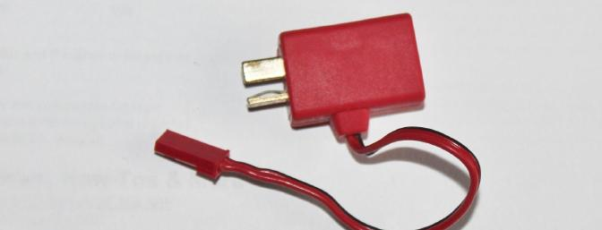 T plug power tap. Goes between battery and ESC and the JST connector powers the lights.