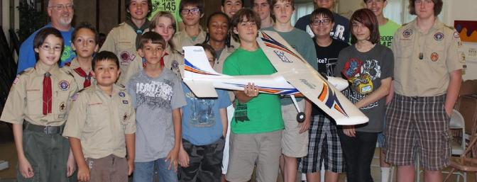 Troop 145 holding my Sensei after a group presentation on aviation to the scouts and some parents.