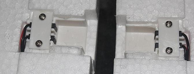 The female servo wire connectors appear recessed because they don't connect to each other but rather they connect to the male connectors in the fuselage shown in the picture above.