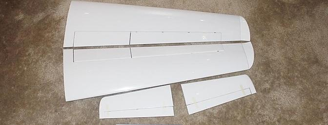 The wings and horizontal stabilizers with elevators arrived in almost perfect shape needing just a few touch ups with my covering iron in its sock.