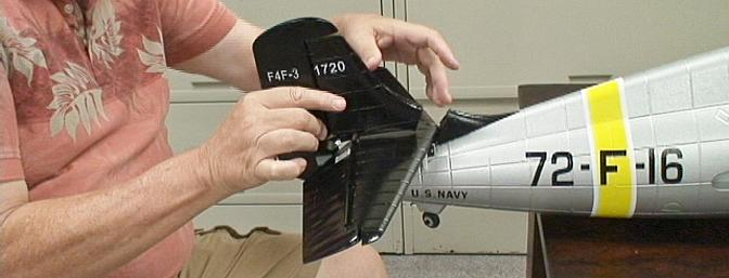 The rudder has a molded piece at the bottom that fits into the horizontal stabilizer.