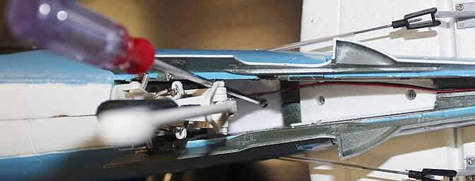 Here you can see the supplied screwdriver putting one of the vertical stabilizers into its mounting hole.