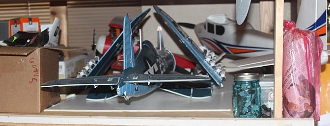 With gear and wings up she is easily stored on one of my plane racks.