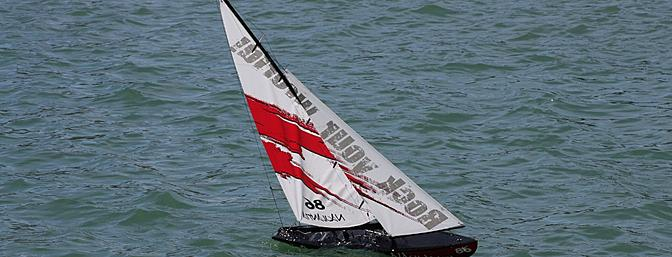 The sail is rigged too tightly to the back of the boom and not enough camber to sail fast.