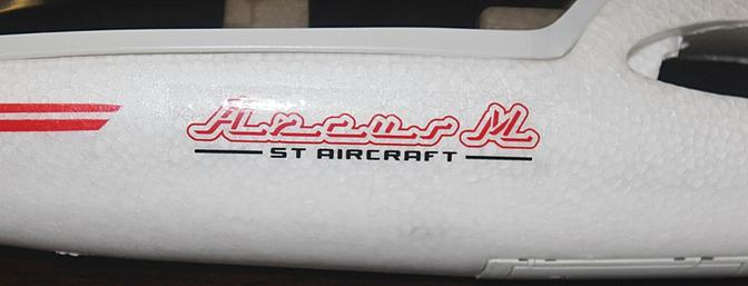 The name of the plane on the side of the fuselage.