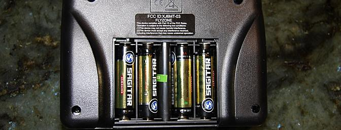 The AA batteries power the transmitter which also serves as a charger.
