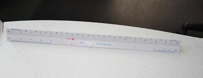 A ruler with a metric side was used to measure where to make the cuts in the aileron hinge line.