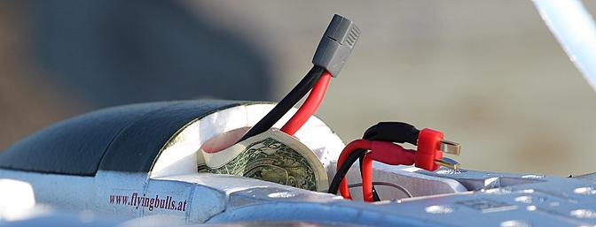 A dollar bill wrapped around the Velcro on the battery makes installing the battery pack into the nacelle much easier.