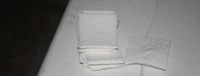 Paper towels cut into small squares to serve as wipes to remove excess CA glue.