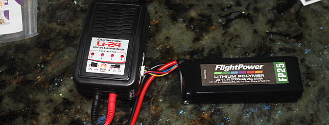 The 11.1V 5000mAh battery being charged with the included LI-24 Balanced Charger.