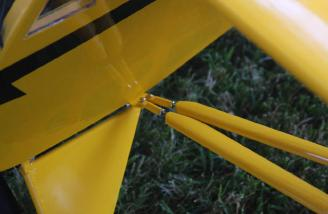 The pins and cotter pins holding the wing struts to the landing gear plate on the fuselage.