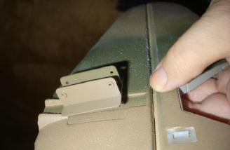 This photo shows the metal piece partially though the horizontal stabilizer.