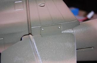 The two 14mm screws secured the vertical stab between two plates.