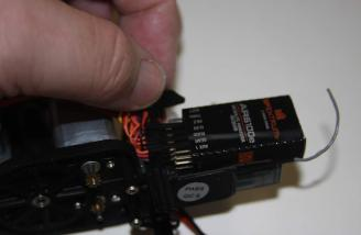 The main unit out of the body looking at the receiver. the binding plug goes in the slot marked battery.