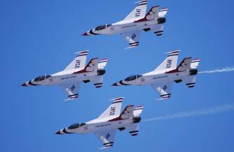 The Air Force Thunderbirds rehearsing earlier this year in their F-16s.