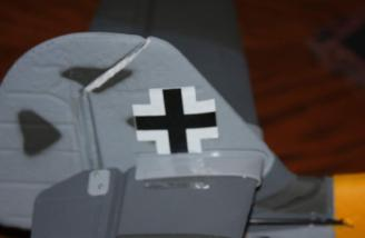 A Maltese cross installed onto the vertical stabilizer.