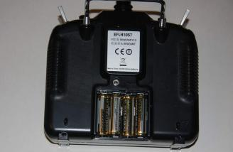 The 4 supplied AA Alkaline Batteries installed into the supplied transmitter